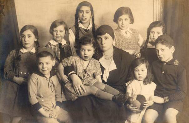 My grandmother with her nine children including my father, in the early 1930s. The three youngest children Ruth, Naomi and Sara in the photo all perished with their parents.